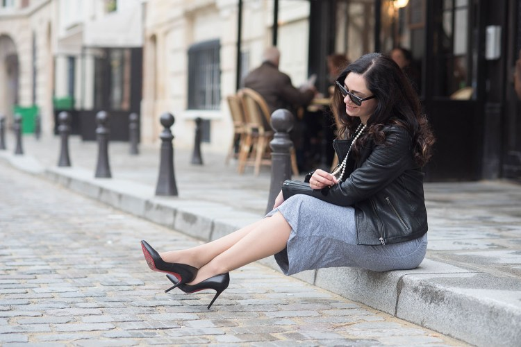 Fashion blogger Cee Fardoe of Coco & Vera at Place Dauphine in Paris wearing a grey Monrow dress and Christian Louboutin Pigalle pumps