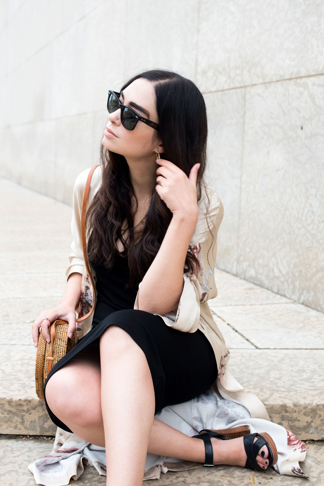 Top Canadian fashion blogger Cee Fardoe of Coco & Vera sits on the steps of the Winnipeg Art Gallery wearing an & Other Stories dress and RayBan sunglasses