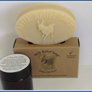 boxed oval bar of Milk Relief Soap™ (70 g) and a small jar of Green Gear Balm (30 ml).