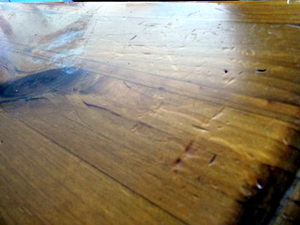 Oil Scrubbing: The top left corner is the heat damage and a little dirt on the varnish.