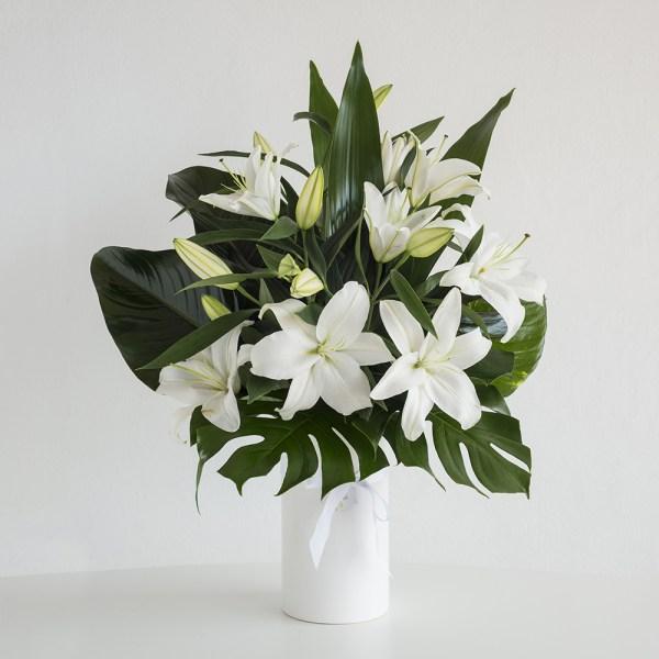 Oriental Lilies in Ceramic Vase