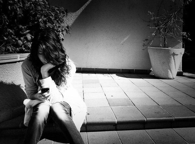 Bored Girl sitting in Shadows