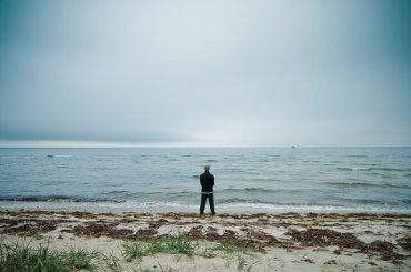 Man in Harmony on Lake