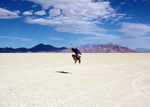 man jumping and looking happy