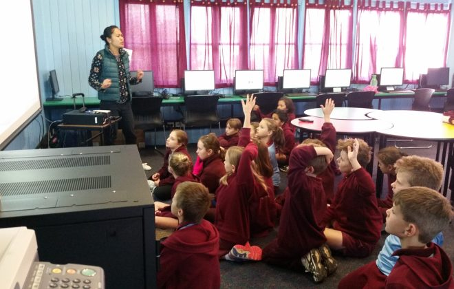 Coding kids Emily teaching