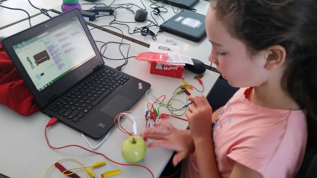 Coding kids student working on makey makey project