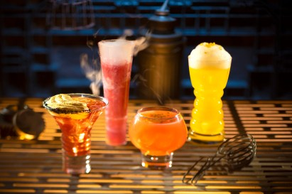 Innovative and creative drinks from around the galaxy will be available at Star Wars: Galaxy's Edge when it opens May 31, 2019, at Disneyland Park in Anaheim, Calif., and Aug. 29, 2019, at Disney's Hollywood Studios in Lake Buena Vista, Fla. From left to right, alcoholic beverages: The Outer Rim, Bespin Fizz, Yub Nub, and Fuzzy Tauntaun can be found at Oga's Cantina inside Star Wars: Galaxy's Edge. (Kent Phillips/Disney Parks)