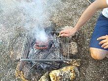 cuisson d'un bar au barbecue