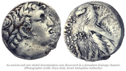 ancient silver coin found in jerusalem drainage channel  israel antiquities authority
