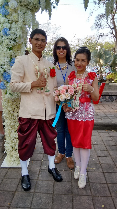 Posing with a Thai couple