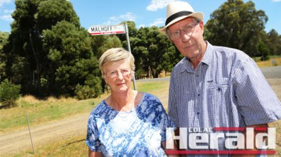 Jennifer Cunnington and Ken Widdowson want Colac Otway Shire Council to change the name of Forrest's Malhoff Road to Curtis Road, after Ms Cunnington's father who built the road and grandfather who was a pioneer in Forrest's history. But the road instead bears the name of a convicted paedophile.