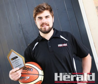 Colac Herald sports editor Ben Martin accepted the Colac Herald's state award for basketball coverage from Basketball Victoria Country.