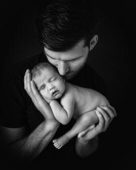 daddy cuddling baby