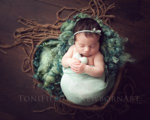 baby in a heart bowl