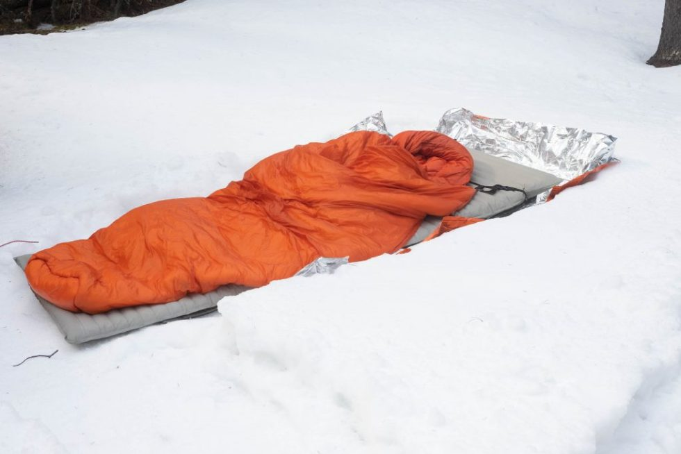 sleeping bag with overquilt quilt over bag.
