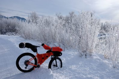 Frosty morning with packed fatbike by the river