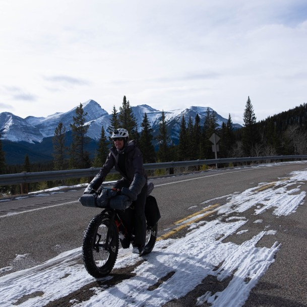 Guy riding up the closed section of highway.