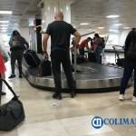 aeropuerto viajeros maletas