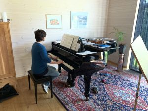 Anne playing the Ronge piano