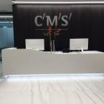 white-corian-reception-desk-two-tier-cms