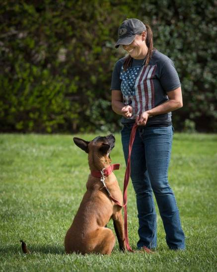 Dog Trainer Meagan Karnes builds engagement with her Belgian Malinois