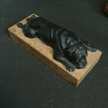 Famous Doris Linder lying bulldog in bronze