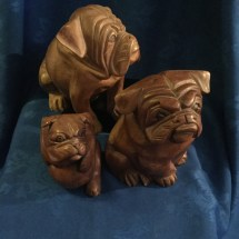 Small seated wooden bulldogs