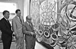 Photograph of Professors Arthur Porter and Marshall McLuhan, with artist René Cera, admiring Cera's mural PIED PIPER ALL, Centre for Culture and Technology, University of Toronto, 1969. Photograph by Robert Lansdale