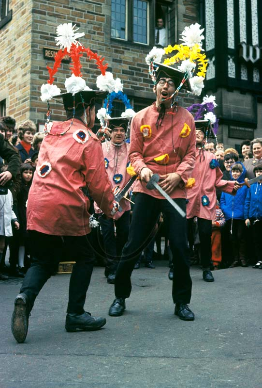 Hector is slain by St George - Midgley Pace Eggers in Todmorden, Calderdale, West Yorkshire, on Good Friday 1965. Photographer: Brian Shuel. http://www.collectionspicturelibrary.co.uk