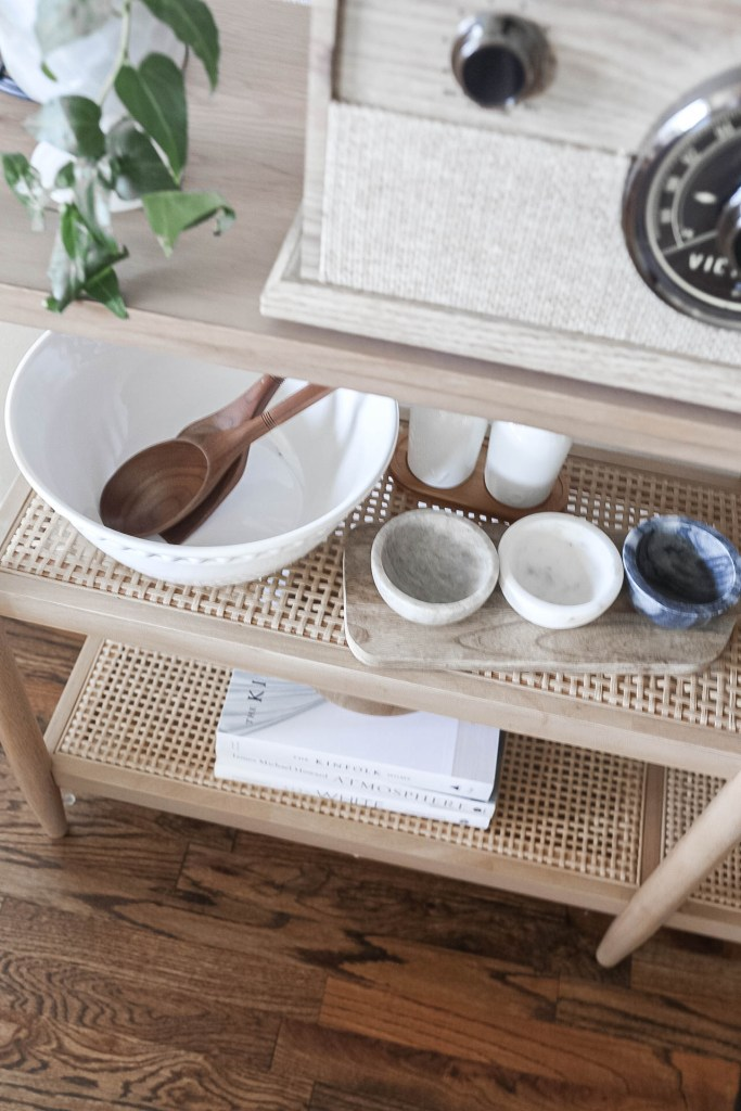 Dining Room Table Bookshelf Decor of Bowls and Serving Utensils
