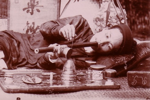 Top: Anti-opium propaganda poster from China, circa 1930. Above: This Vietnamese smoker's layout included a hardwood tray with mother-of-pearl inlay and miniature, spittoon-shaped pots on which to rest pipe-bowls.
