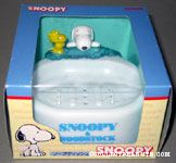 Snoopy & Woodstock peaking over the edge of a Soap Dish