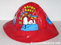 Snoopy on doghouse with Woodstocks holding umbrellas 'Rainy Days' Rain Hat
