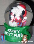 Santa Snoopy in gift bag Snowglobe