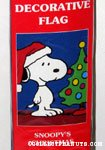 Snoopy standing next to Christmas Tree Flag