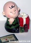 Charlie Brown holding Christmas Gift Music box