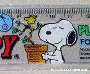 Snoopy holding potted tree with Woodstock singing Ruler