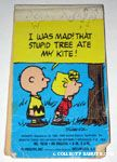 Charlie Brown and Sally looking at Tree notebook
