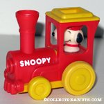 Snoopy driving a Train Engine