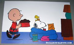 Snoopy sitting in bean bag chair with snacks and Charlie Brown with dog dish Placemat