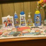 Peanuts bath soaps, tissue box cover and dresser scarf.