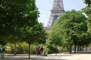 Eiffel Tower Family leaving Champ de Mars gardens - April