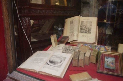 Antique books in a shop window along a street in Paris