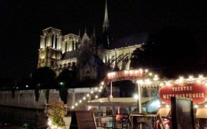 Notre Dame is the backdrop for Theatre Metamorphosis Magic Show on the Seine