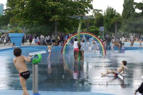 Children playing in the water Jardin d'Acclimatation Bois de Boulogne children's amusement park with a zoo, the Exploradôme museum, and other attractions