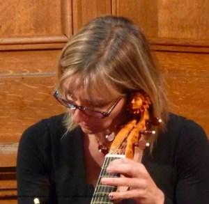 Musician playing viola de Gamba during concert Temple Protestant du Foyer de l'Ame, 7 Rue du Pasteur Wagner, 75011 Paris