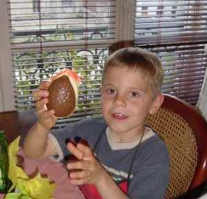 Child holding chocolate easter egg