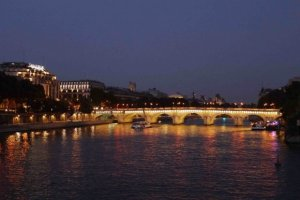 Seine in the evening with Pont Neuf illuminated and Samaritaine to the left