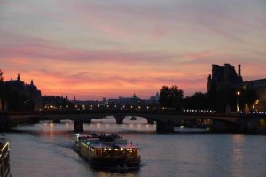 Dinner barge/peniche in the Paris sunset facing the Pont du Carrousel