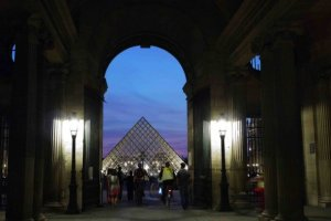 Biking through the archway toward the Louvre pyramid from Cour Carée